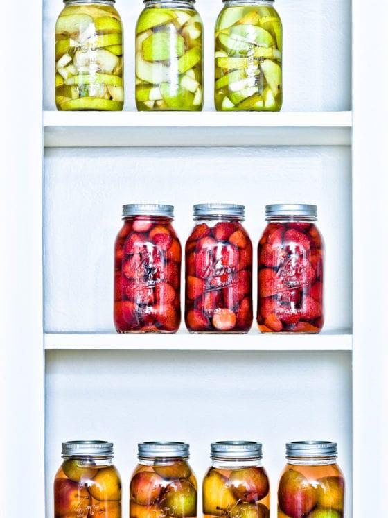 An image of a shelf of jars of fruit