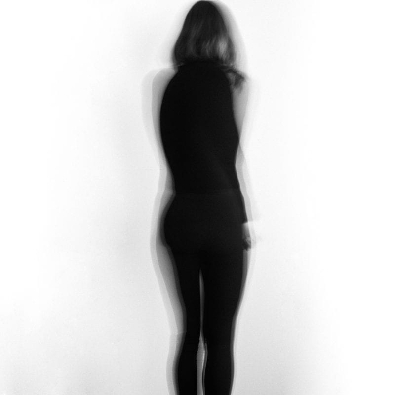 A blurry image of the figure of a woman