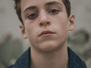 An upclose photo of a teen boy's face