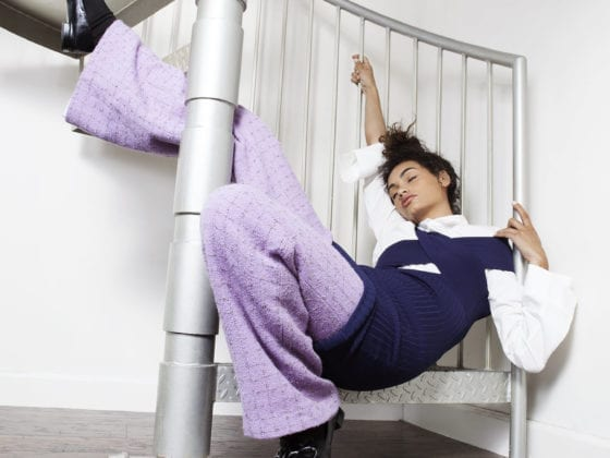 A woman collapsed on a set of spiral stairs