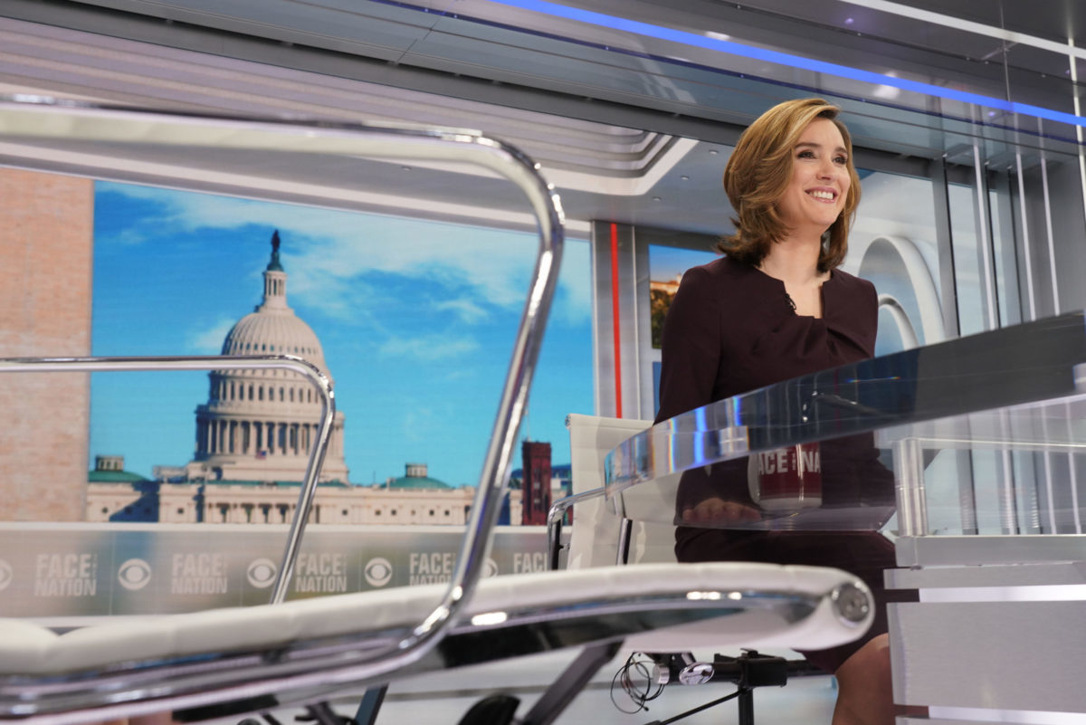 A woman sitting at her news anchor desk