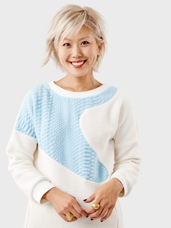 A woman in a blue and cream sweater