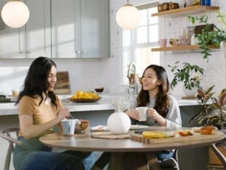 Two women sitting at a kitchen table