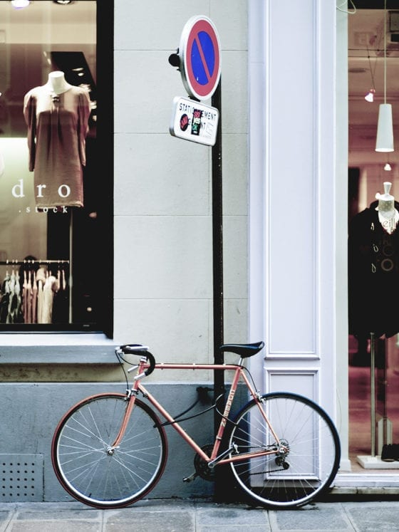 A picture of a bike outside a store window