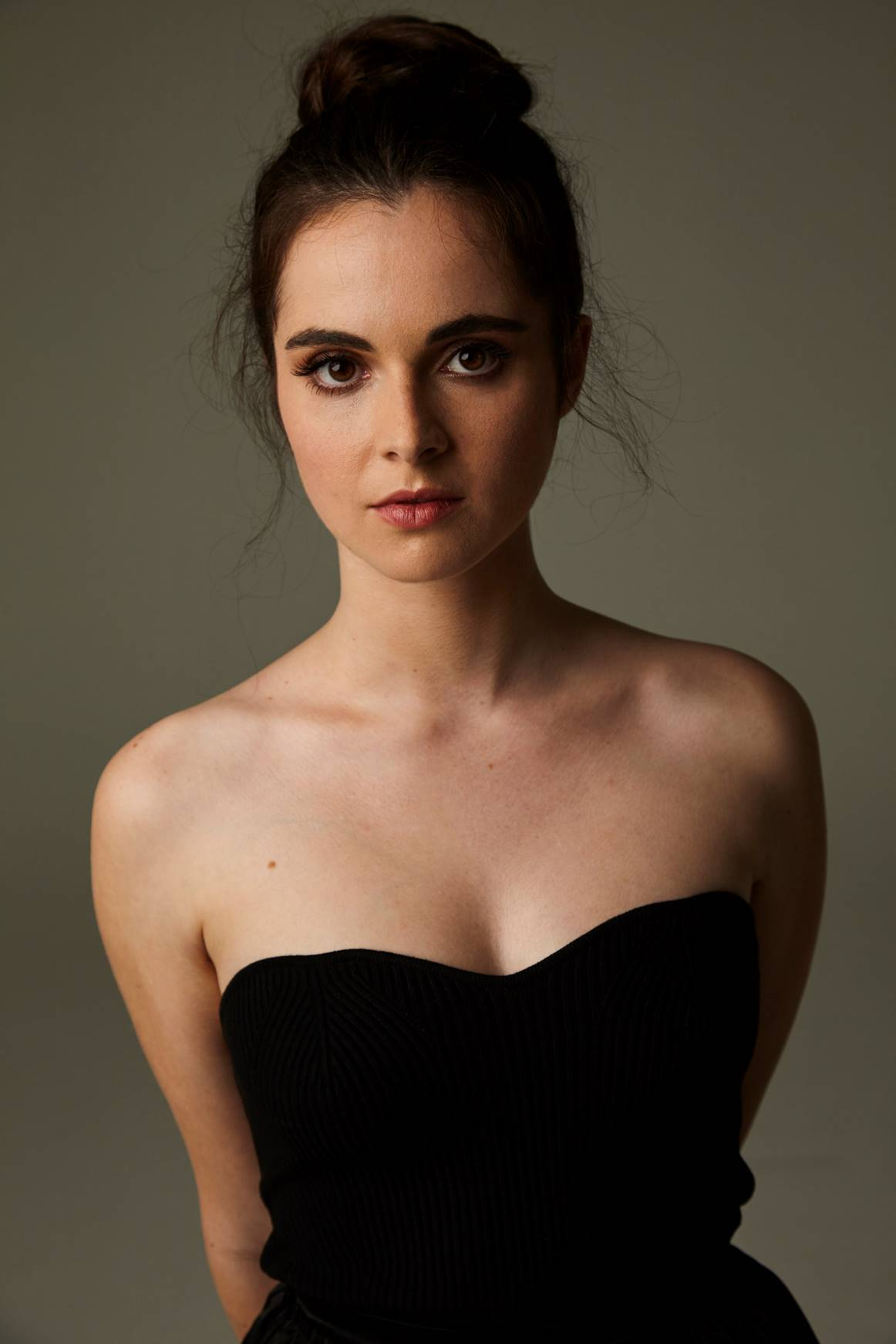 A picture of a girl wearing a strapless black dress