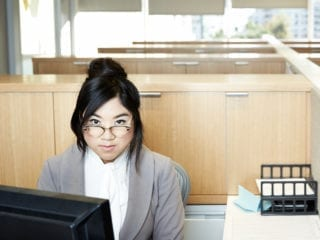 A woman seated at an office desk