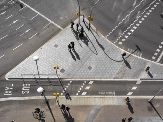 A busy intersection at a road with pedestrians